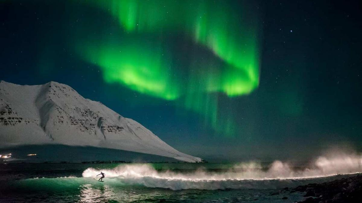 Surfing Iceland Beneath the Northern Lights – Brace for the Storm and Surf!